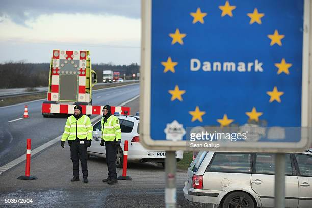 Danish police conducting spot checks on incoming traffic from Germany stand at the A7 highway border crossing on January 6 2016 near Padborg Denmark...