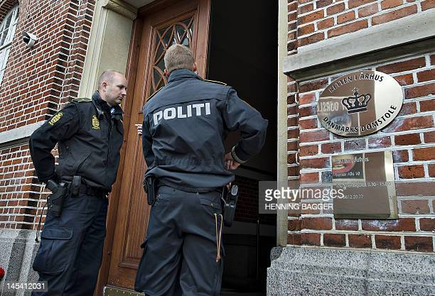 Danish police officers stand outside the court in Aarhus on May 29 2012 during the closeddoor hearing of two brothers of Somali origin who were...