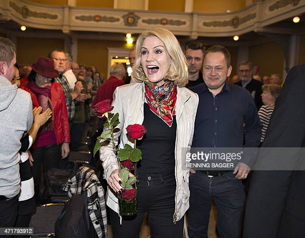 Danish Prime Minister and chairman of the Social Democrats Helle ThorningSchmidt reacts when she arrives in Randers where she will give the first...