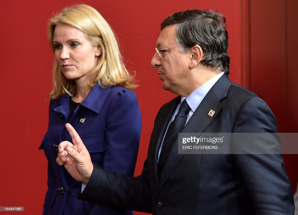 Danish Prime Minister Helle Thorning-Schmidt (L) and European Commission President Jose Manuel Barroso talk as they arrive for a family photo at an EU summit in Brussels on October 18, 2012. EU leaders today go into the first of three summits before Christmas on strengthening the bloc's foundations, with France saying an end to the crippling eurozone debt crisis is 'very close.' FEFERBERG