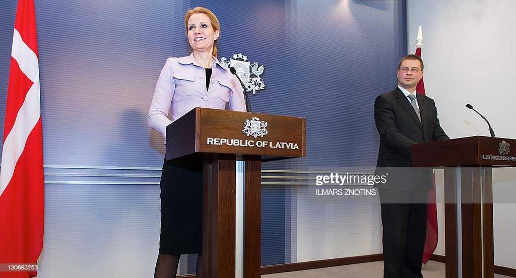 Danish Prime Minister Helle Thorning-Schmidt (L) and her Latvian counterpart Valdis Dombrovskis (R) give a press conference after their meeting in Riga on October 28, 2011.