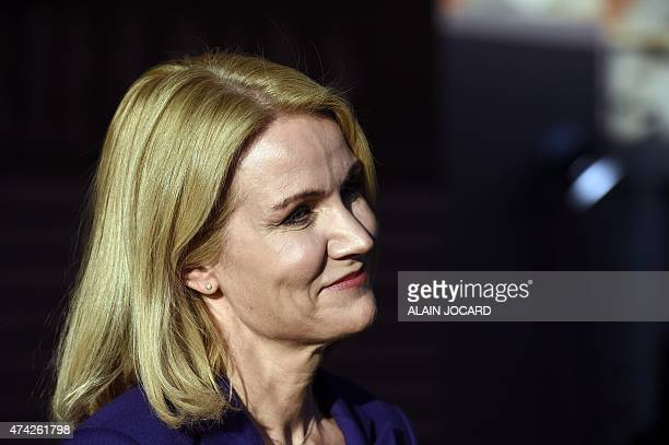 Danish Prime minister Helle ThorningSchmidt answers journalists upon arrival at the House of the Blackhead for an informal dinner at the start of the...