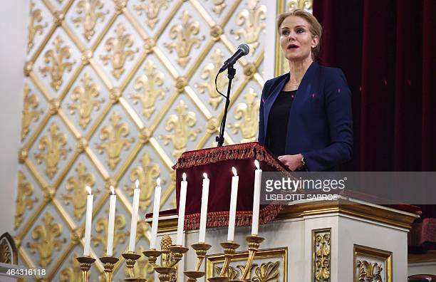 Danish Prime Minister Helle ThorningSchmidt delivers a speech in the Jewish synagogue in Copenhagen on Febuary 24 at a memorial service for Dan Uzan...