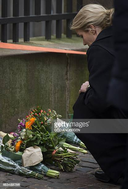 Danish prime minister Helle ThorningSchmidt lays flowers outside the synagogue Krystalgade in Copenhagen on February 15 2015 after two fatal attacks...