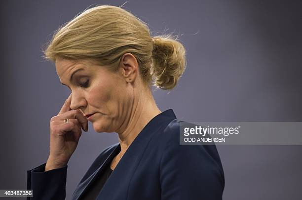 Danish prime minister Helle ThorningSchmidt reacts during a press briefing in Copenhagen on February 15 2015 after two fatal attacks in the Danish...
