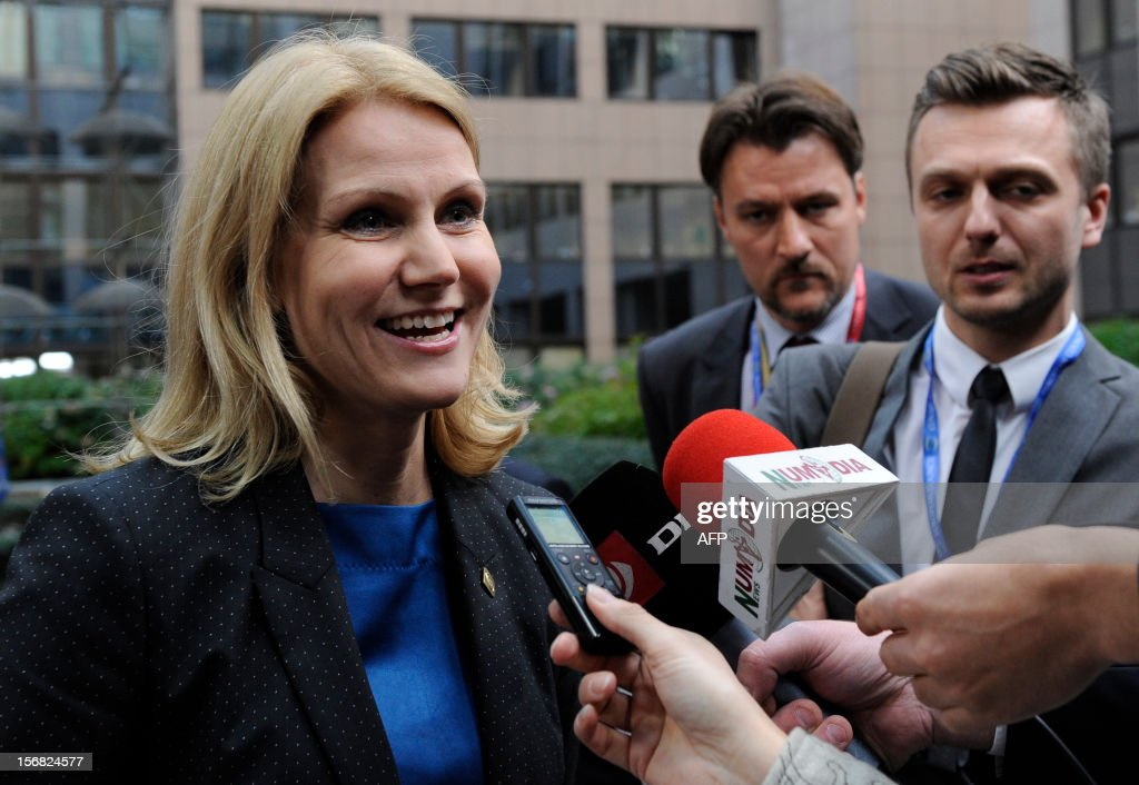 Danish Prime Minister Helle Thorning-Schmidt talks to journalists as she leaves the EU Headquarters on November 22, 2012 in Brussels, during a two-day European Union leaders summit called to agree a hotly-contested trillion-euro budget through 2020. European Union officials were scrambling to find an all but impossible compromise on the 2014-2020 budget that could successfully move richer nations looking for cutbacks closer to poorer ones who look to Brussels to prop up hard-hit industries and regions.