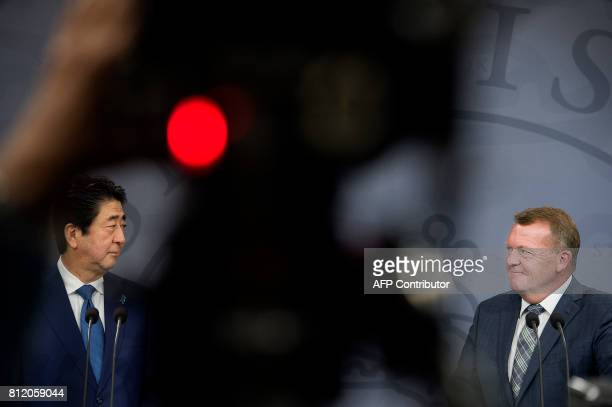 Danish prime minister Lars Loekke Rasmussen and Japanese Prime minister Shinzo Abe give a press conference afrer a meeting in Copenhagen on July 10...