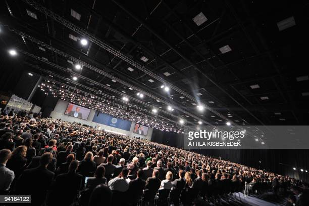 Danish Prime Minister Lars Loekke Rasmussen delivers a speech at the Bella center in Copenhagen on December 7 2009 during the opening ceremony of the...