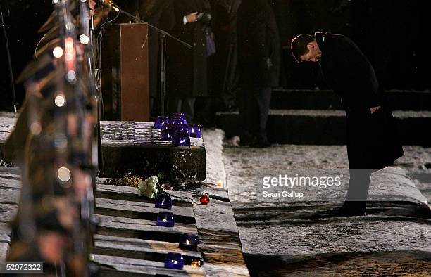 Danish Prince Joachim bows after laying a candle at the main memorial during ceremonies marking the 60th anniversary of the liberation of the...