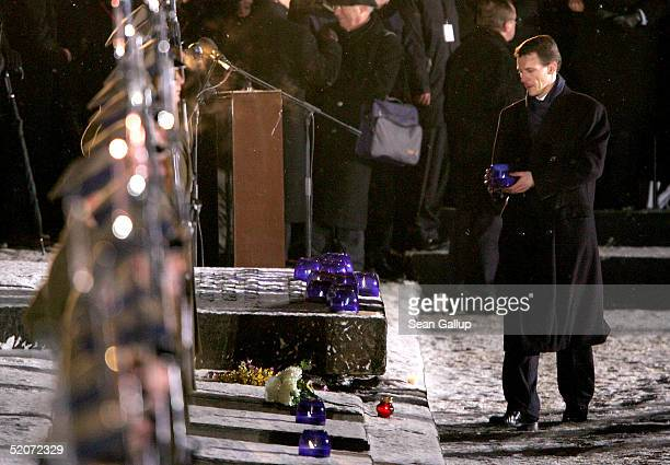 Danish Prince Joachim carries a candle at the main memorial during ceremonies marking the 60th anniversary of the liberation of the Auschwitz...