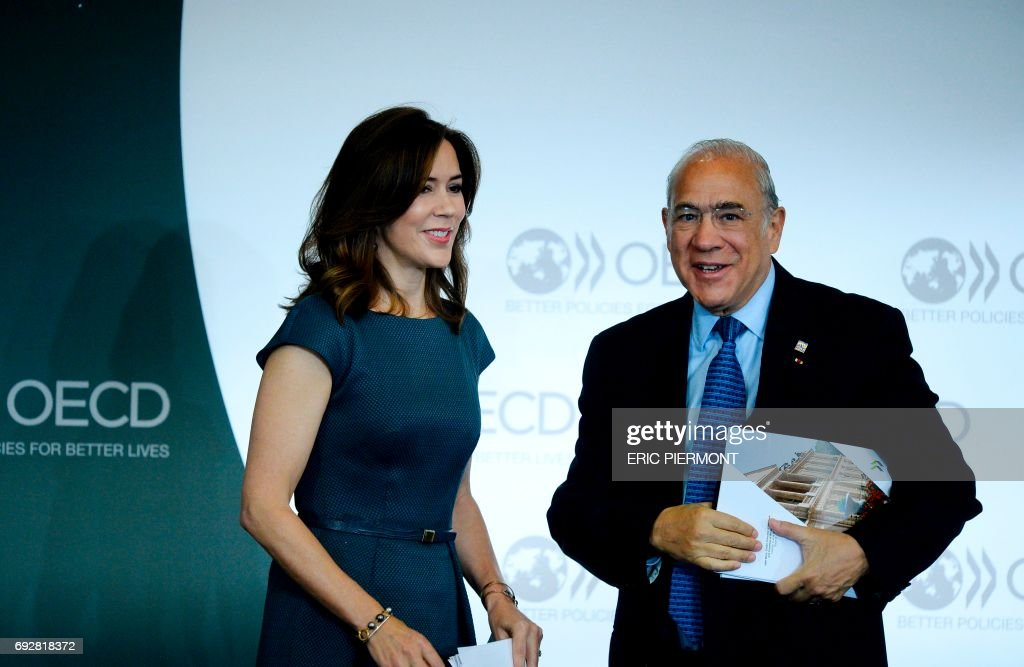 Danish Princess Mary (L) and OECD Secretary General Angel Gurria attend the OECD Forum 2017 opening on June 6, 2017 at the OECD headquarters in Paris. /