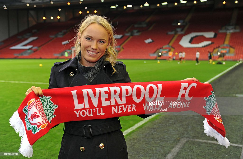 Danish professional tennis player Caroline Wozniaki poses before the Barclays Premier League match between Liverpool and West Bromwich Albion at Anfield on October 26, 2013 in Liverpool, England. Former World Number 1 on the WTA Tour, the tennis star was making her first visit of the season to the home of the Reds to see the match against West Bromwich Albion. Caroline will certainly be invited again after the Reds won 4 - . A well-known fan of Liverpool FC, in 2011 Wozniaki famously sported a signed Steven Gerrard shirt during her quarter-final victory of the Qatar Open and has tweeted out her love for the Club to her 560k followers whilst watching matches from all over the world.