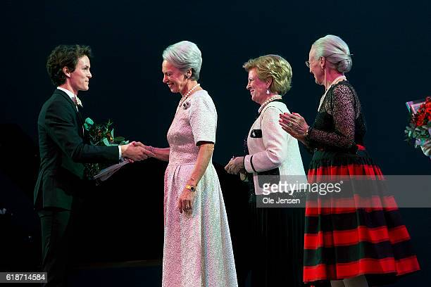 Danish Queen Margrethe and her sisters Princess Bennedikte and Queen AnneMarie of Greece gratulate young ballet dancer Andreas Kaas during after...
