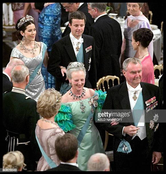 Danish Queen Margrethe and Prince Consort Henrik followed by their son Danish Crown Prince Frederik and his Australian fiancee Mary Donaldson arrive...
