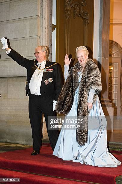 Danish Queen Margrethe II and her consort Prince Henrik arrive to the New Year's reception at the royal palace Amalienborg in Copenhagen January 1...