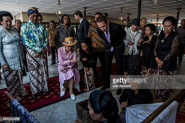 Danish Queen Margrethe II listens as she watches the process of making batik during meets with Sri Sultan Hamengkubuwono X as her visit at Kraton...