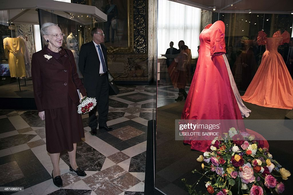 Danish Queen Margrethe (front) inspects the exhibition 'Her Majesty the Queen 75 years - a costume cavalcade' with Museum Director Mette Skougaard (back) at the Museum of National History at Frederiksborg Castle in Hilleroed, north of Copenhagen on March 25, 2015. The special exhibition is a costume cavalcade of the queen's life.