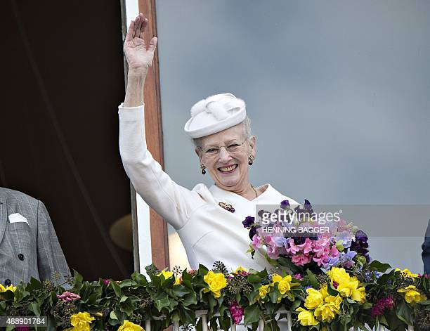 Danish Queen Margrethe waves to the attendees from the balcony at Aarhus City Hall on April 8 as a prelude to the celebration of Queen Margrethe's...