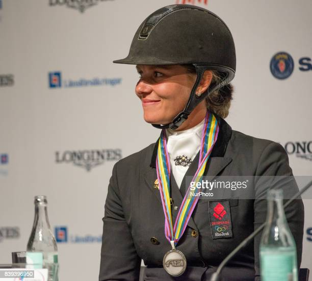 Danish rider Anna Kasprzak meets the press after winning the silver medal in the team dressage competition of the 2017 FEI European Championships in...