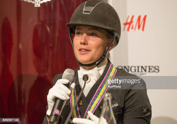 Danish rider Cathrine Dufour meets the press after clinching the silver medal for her team in the team dressage competition at the 2017 FEI European...