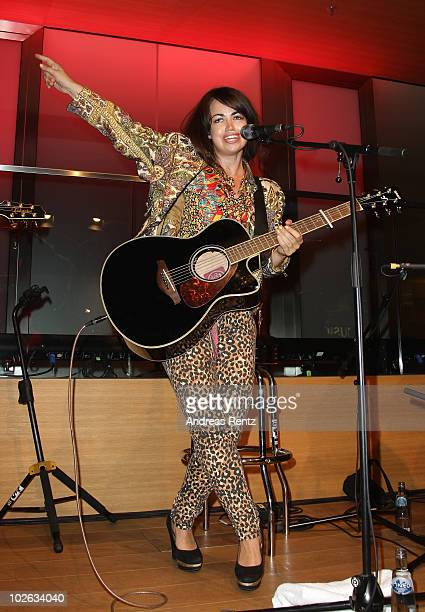 Danish singer Aura Dione performs during the Universal Pop up store opening party at Q110 on July 5 2010 in Berlin Germany