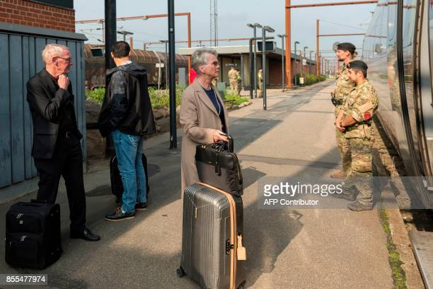 Danish soldiers are pictured at the DanishGerman border train station in Padborg on September 29 2017 Armed forces have been deployed across Denmark...