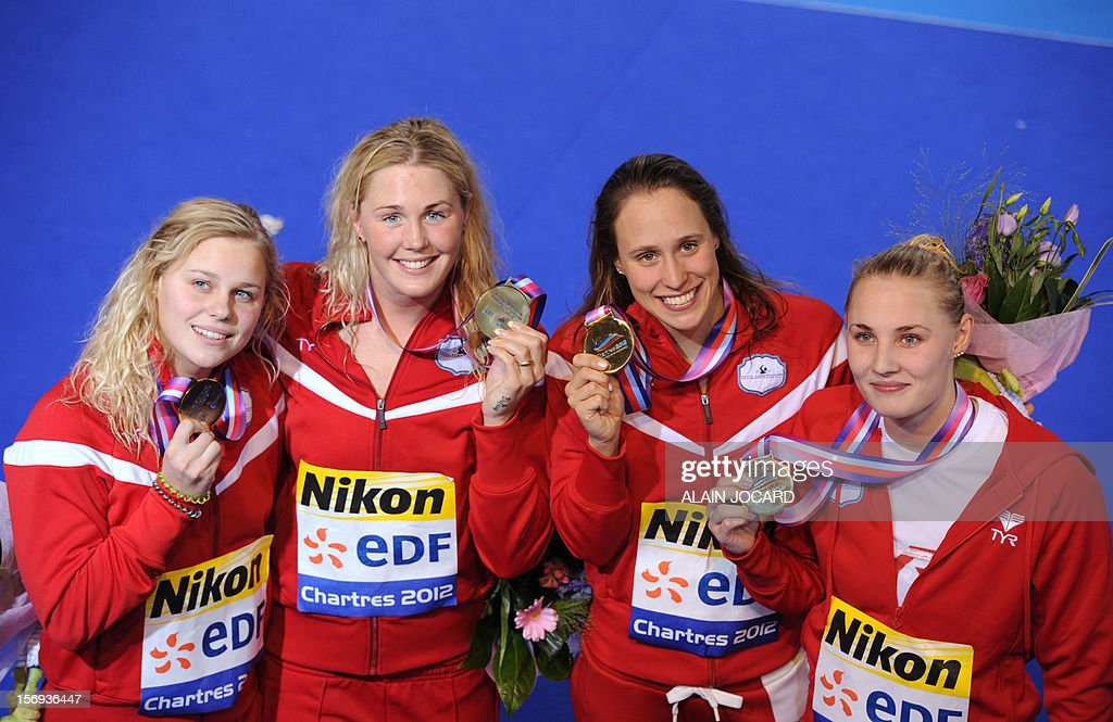 Danish swimmers Kristina Thomsen, Jeanette Ottesen Gray, Pemille Blume, and Rikke Moeller Pedersen pose with their gold medals after winning the women's 4X50m medley relay final at the European short course swimming championships, on November 25, 2012, in Chartres. AFP PHOTO/ ALAIN JOCARD
