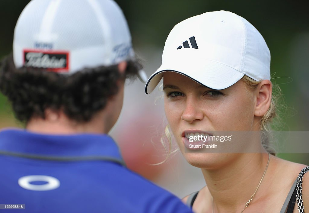Danish tennis satr Caroline Wozniack, talks with her boyfriend Rory McIlroy of Northern Ireland during the resumption of the rain delayed second round of the Barclays Singapore Open at the Sentosa Golf Club on November 10, 2012 in Singapore.