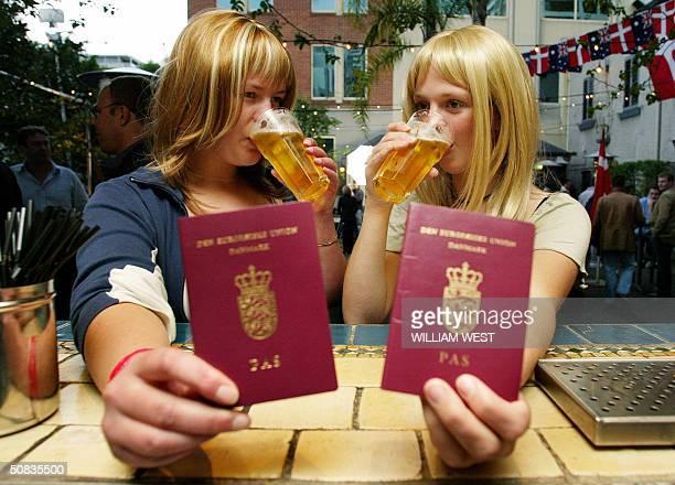 Danish tourists Maria Ekgreen and Maria Kjaer from Copenhagen enjoy free beer when presenting their Danish passport at the SlipInn in Sydney 14 May...