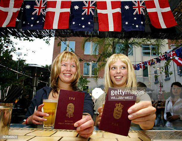 Danish tourists Maria Ekgreen and Maria Kjaer from Copenhagen enjoy free beer when presenting their Danish passport at the SlipInn in Sydney 14 May...