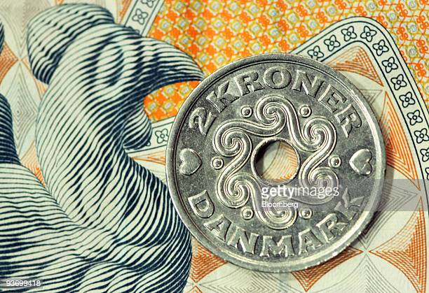 A Danish two krone coin is arranged for a photograph in London UK on Thursday Dec 3 2009 DenmarkÕs currency reserves rose by 73 billion kroner to...