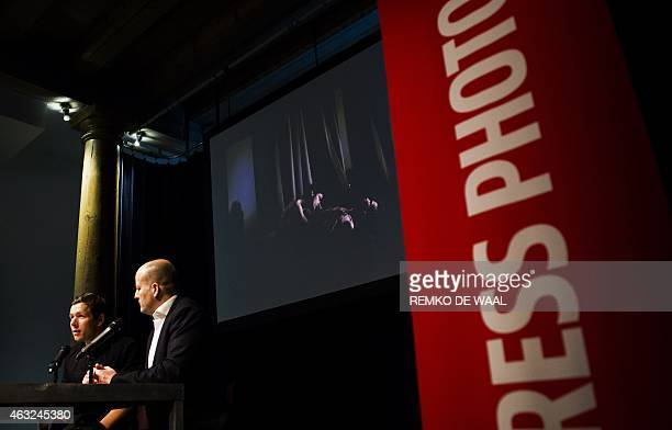 Danish winning photographer Mads Nissen gives a press conference with World Press Photo director Lars Boering during the 2014 World Press Photo Award...