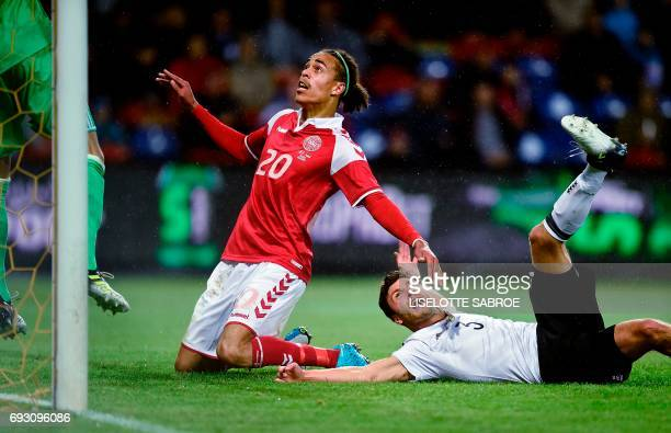 Danish Yussuf Yurary Poulsen and Germany's Jonas Hector eye the ball during their international friendly football match Denmark vs Germany at Brondby...