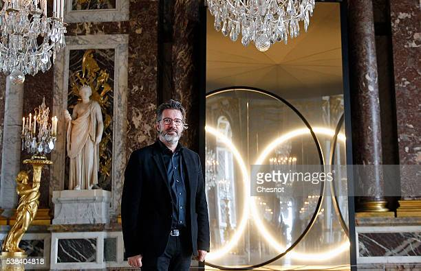 DanishIcelandic artist Olafur Eliasson poses in front of his artwork named 'Your sense of unity' at the opening of the exhibition of his works in the...