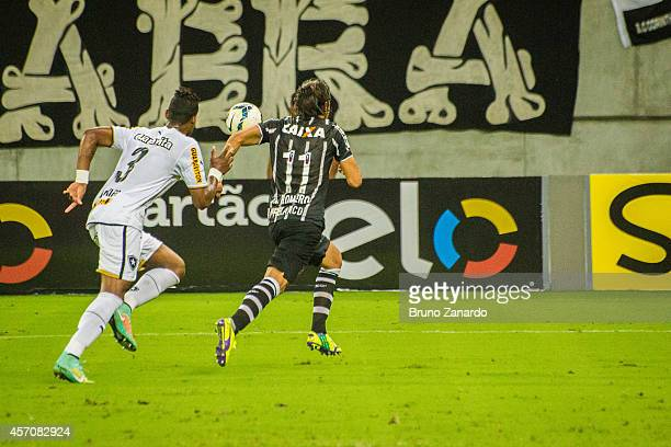 Dankler of Botafogo battles for the ball with ngel Romero of Corinthians during the Brasileirao Series A 2014 match between Corinthians and Botafogo...