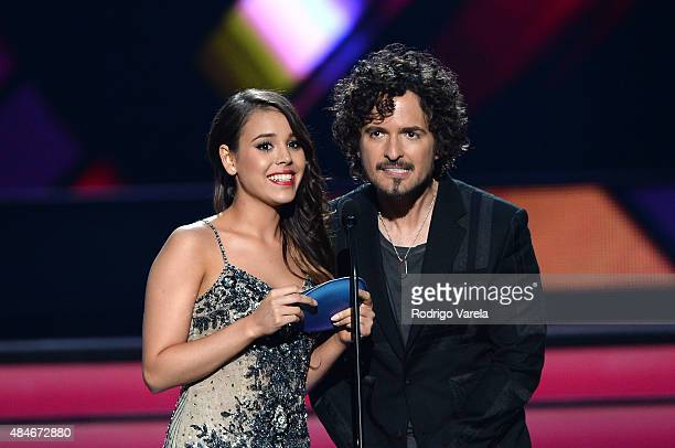 Danna Paola and Tommy Torres speak onstage at Telemundo's 'Premios Tu Mundo' Awards 2015 at American Airlines Arena on August 20 2015 in Miami Florida