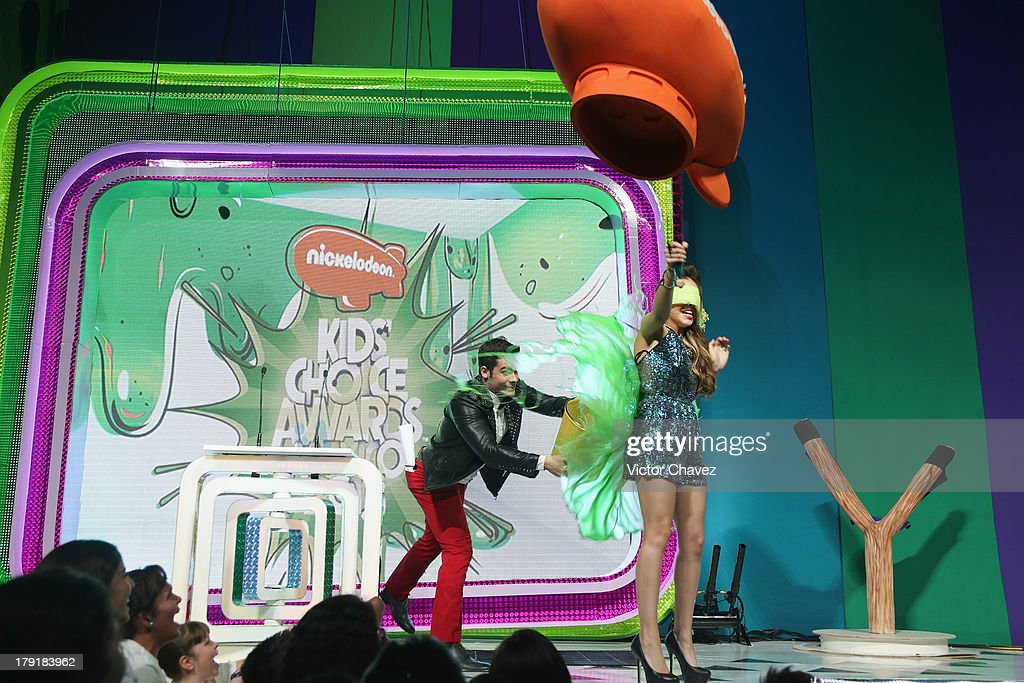 <a gi-track='captionPersonalityLinkClicked' href=/galleries/search?phrase=Danna+Paola&family=editorial&specificpeople=5853275 ng-click='$event.stopPropagation()'>Danna Paola</a> (R) getting slimed onstage during the Kids Choice Awards Mexico 2013 at Pepsi Center WTC on August 31, 2013 in Mexico City, Mexico.