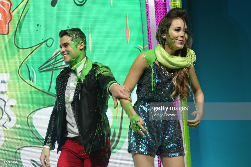 <a gi-track='captionPersonalityLinkClicked' href=/galleries/search?phrase=Danna+Paola&family=editorial&specificpeople=5853275 ng-click='$event.stopPropagation()'>Danna Paola</a> (R) speaks onstage after getting slimed during the Kids Choice Awards Mexico 2013 at Pepsi Center WTC on August 31, 2013 in Mexico City, Mexico.