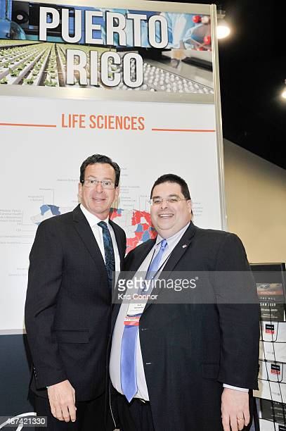 Dannel Malloy and Juan Hernandez pose for a photo during the Department of Commerce's SelectUSA Investment Summit on March 24 2015 in National Harbor...