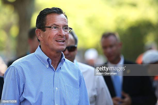 Dannel Malloy the Governor of Connecticut tours the grounds on day 4 of the Connecticut Open at the Connecticut Tennis Center at Yale on August 24...