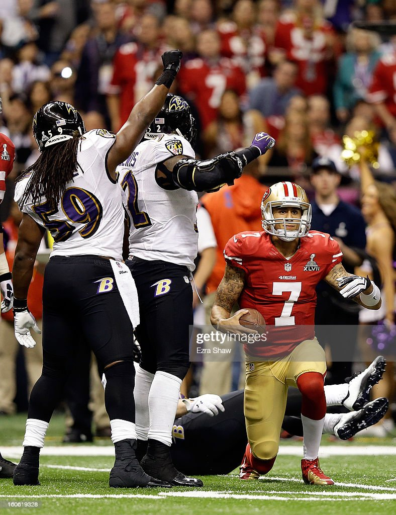 Dannell Ellerbe #59 and Ray Lewis #52 of the Baltimore Ravens react after Colin Kaepernick #7 of the San Francisco 49ers failed to convert on third down in the third quarter during Super Bowl XLVII at the Mercedes-Benz Superdome on February 3, 2013 in New Orleans, Louisiana.