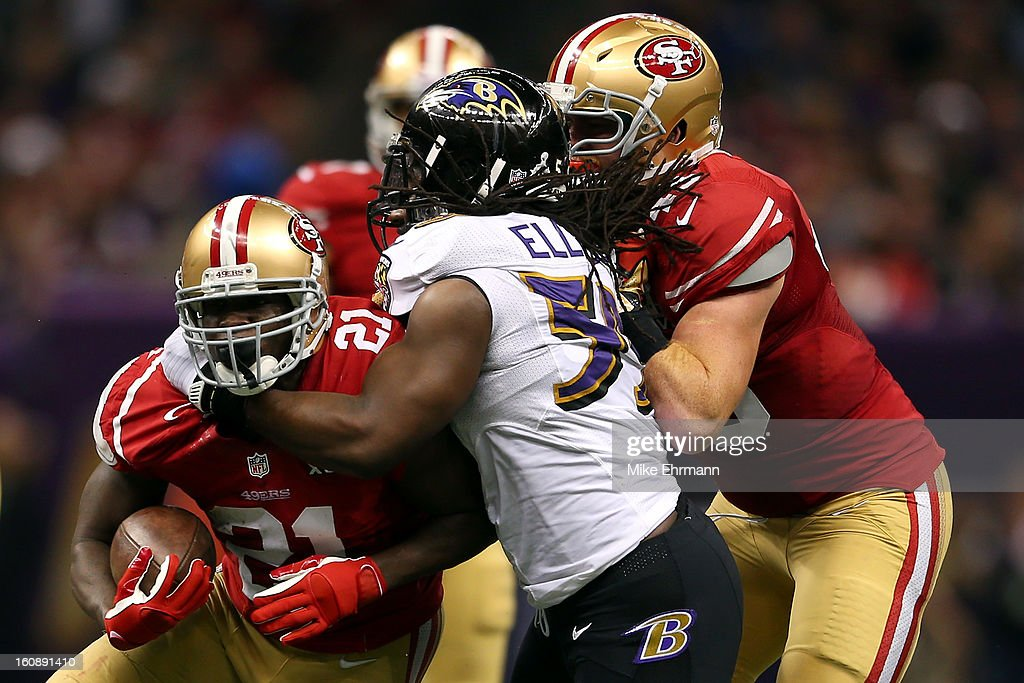 Dannell Ellerbe #59 of the Baltimore Ravens attempts to tackle Frank Gore #21 of the San Francisco 49ers during Super Bowl XLVII at the Mercedes-Benz Superdome on February 3, 2013 in New Orleans, Louisiana. The Ravens won 34-31.