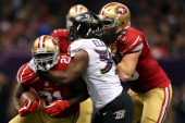 Dannell Ellerbe of the Baltimore Ravens attempts to tackle Frank Gore of the San Francisco 49ers during Super Bowl XLVII at the MercedesBenz...