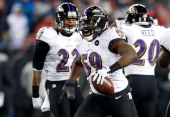 Dannell Ellerbe of the Baltimore Ravens celebrates after intercepting a pass by Tom Brady of the New England Patriots in the fourth quarter during...