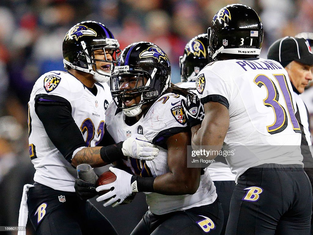 Dannell Ellerbe #59 of the Baltimore Ravens celebrates with his teammates after intercepting a pass by Tom Brady #12 of the New England Patriots in the fourth quarter during the 2013 AFC Championship game at Gillette Stadium on January 20, 2013 in Foxboro, Massachusetts.