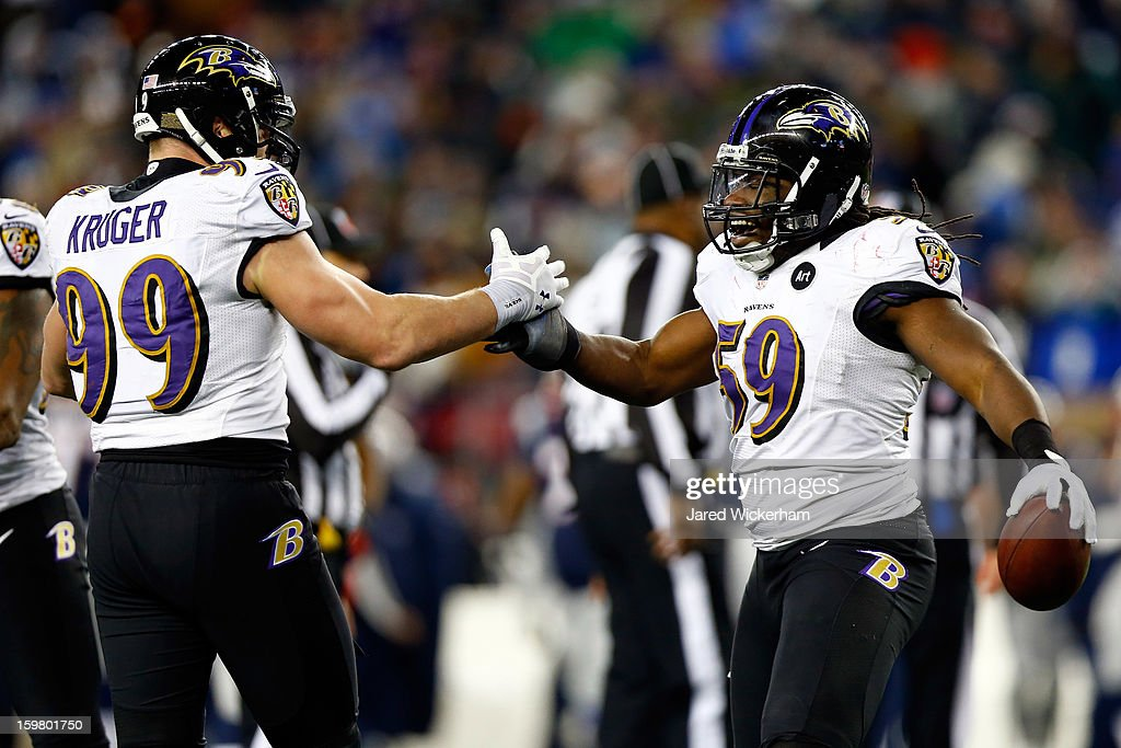 Dannell Ellerbe #59 of the Baltimore Ravens celebrates with teammate Paul Kruger #99 after intercepting a pass by Tom Brady #12 of the New England Patriots in the fourth quarter during the 2013 AFC Championship game at Gillette Stadium on January 20, 2013 in Foxboro, Massachusetts.