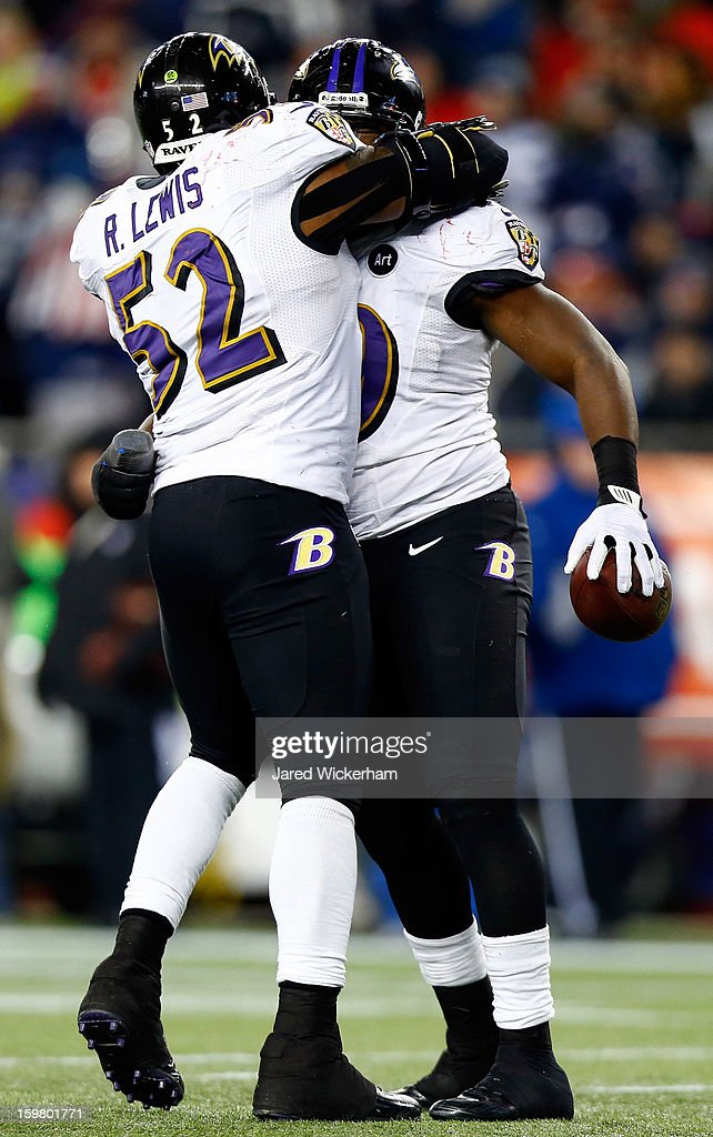 Dannell Ellerbe #59 of the Baltimore Ravens celebrates with teammate Ray Lewis #52 after intercepting a pass by Tom Brady #12 of the New England Patriots in the fourth quarter during the 2013 AFC Championship game at Gillette Stadium on January 20, 2013 in Foxboro, Massachusetts.