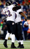 Dannell Ellerbe of the Baltimore Ravens celebrates with teammate Ray Lewis after intercepting a pass by Tom Brady of the New England Patriots in the...