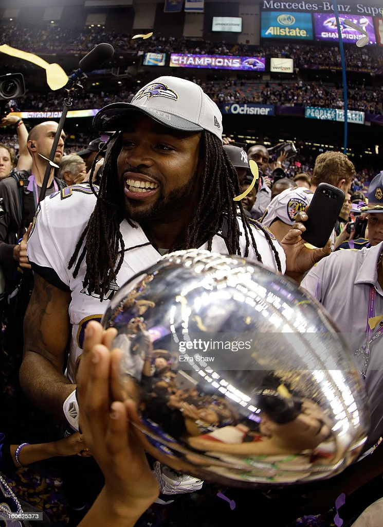 Dannell Ellerbe #59 of the Baltimore Ravens celebrates with the Vince Lombardi Trophy following their 34-31 win against the San Francisco 49ers during Super Bowl XLVII at the Mercedes-Benz Superdome on February 3, 2013 in New Orleans, Louisiana.