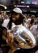 Dannell Ellerbe of the Baltimore Ravens celebrates with the Vince Lombardi Trophy following their 3431 win against the San Francisco 49ers during...